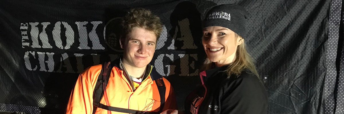 Chief Operating Officer of the Kokoda Youth Foundation Johllene Elson greeting Sam Barham at the finish line of the Kokoda Virtual Challenge