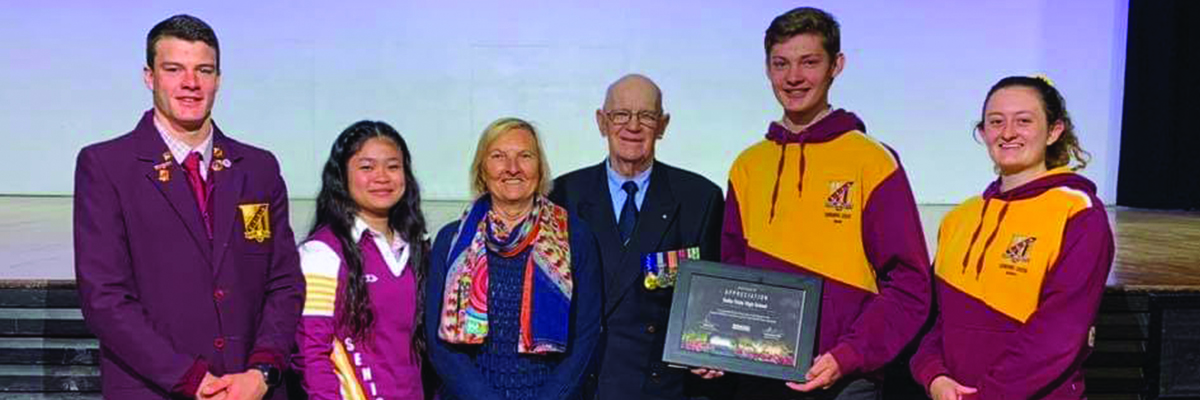 Doug and Anna Henderson present the students of Dalby State High School with a Kokoda Challenge certificate