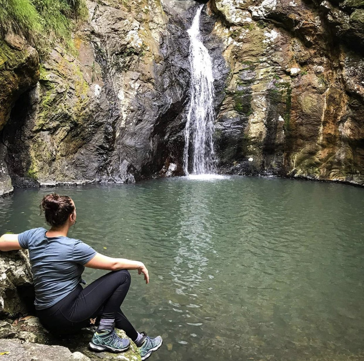 Girl sitting in front of Gorge Falls in Tallebudgera Valley for the Kokoda Virtual Challenge